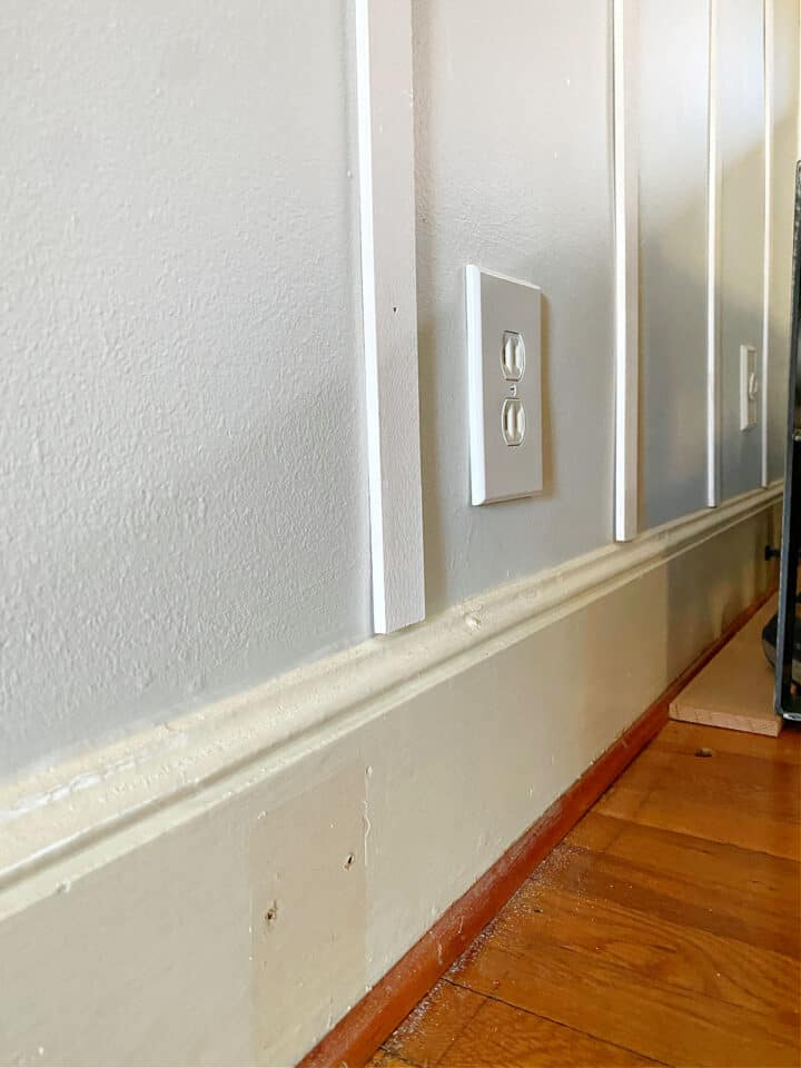 white wood battens resting on wall trim
