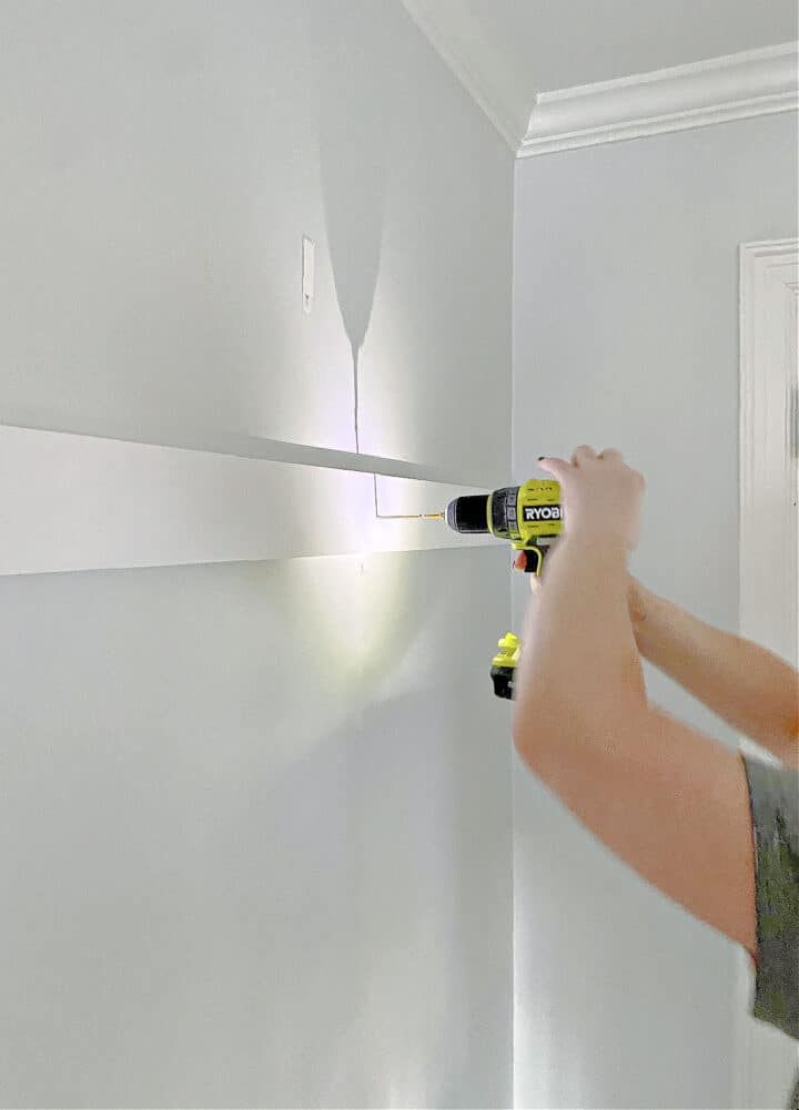 screwing in DIY board and batten with a drill