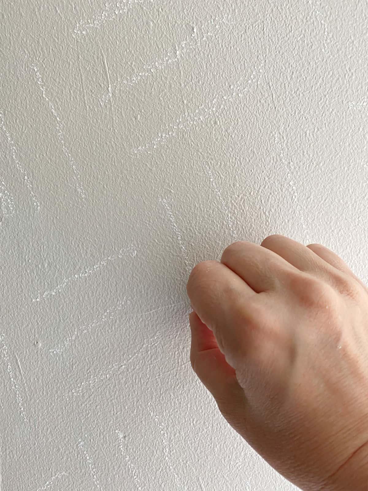 using chalk to create a DIY wall treatment