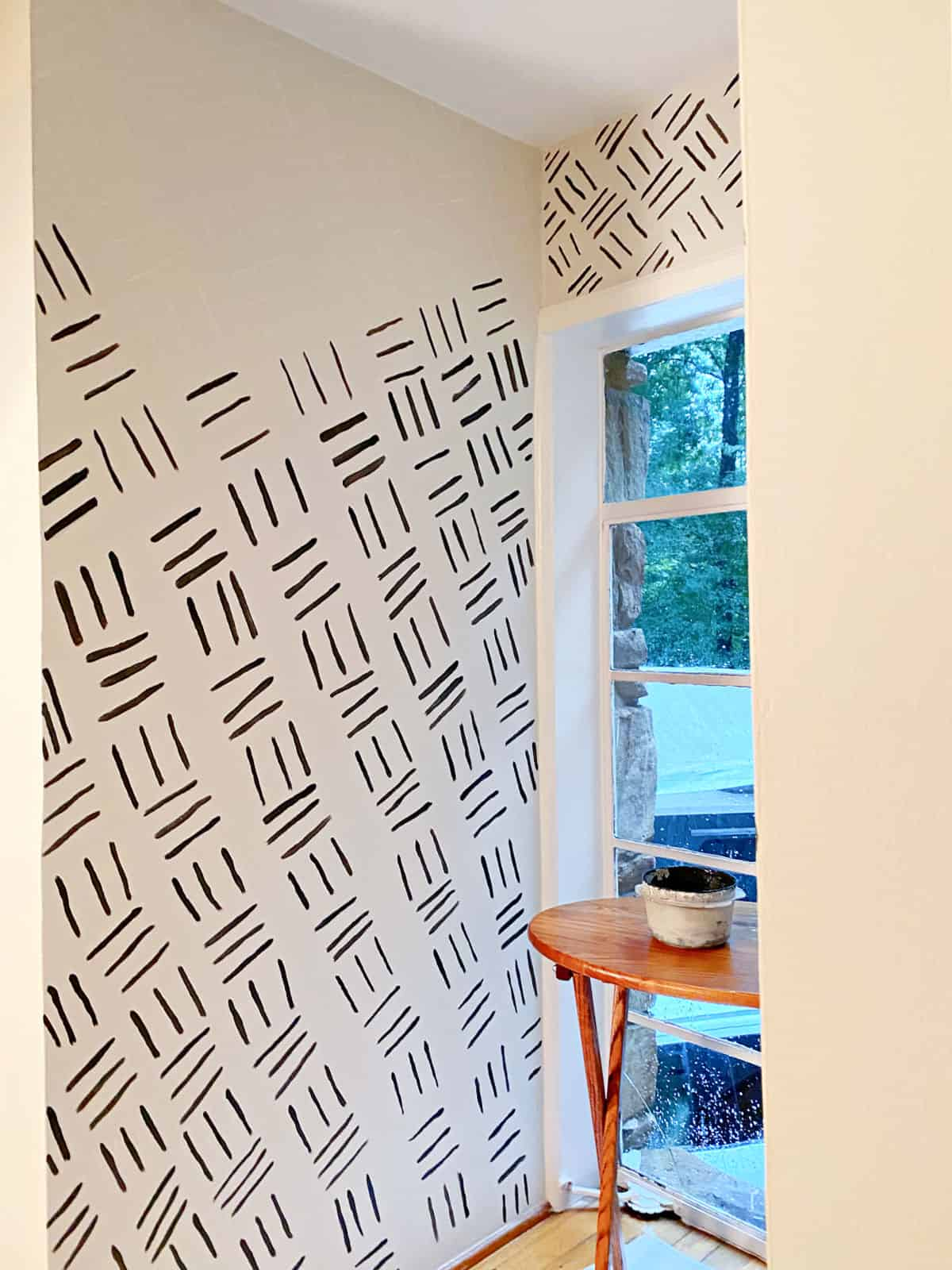 hand-painted accent wall getting painted