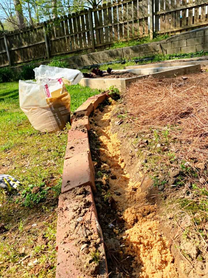 paver sand in trench for brick border