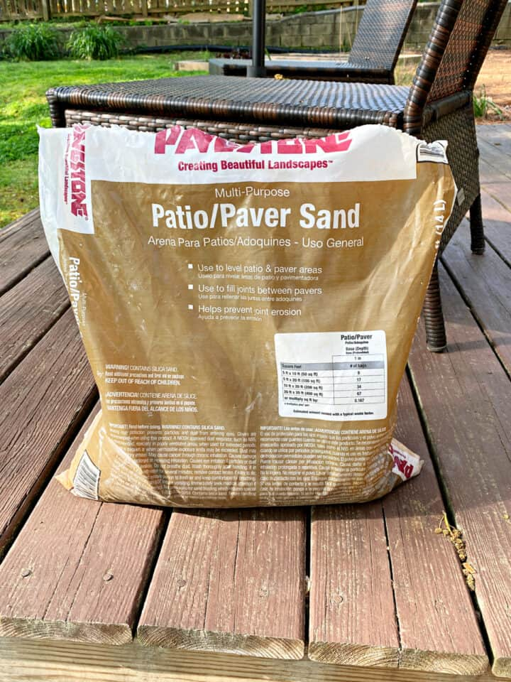 bag of paver sand sitting on backyard deck