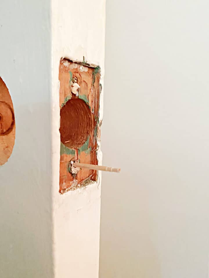 toothpicks in screw holes in door