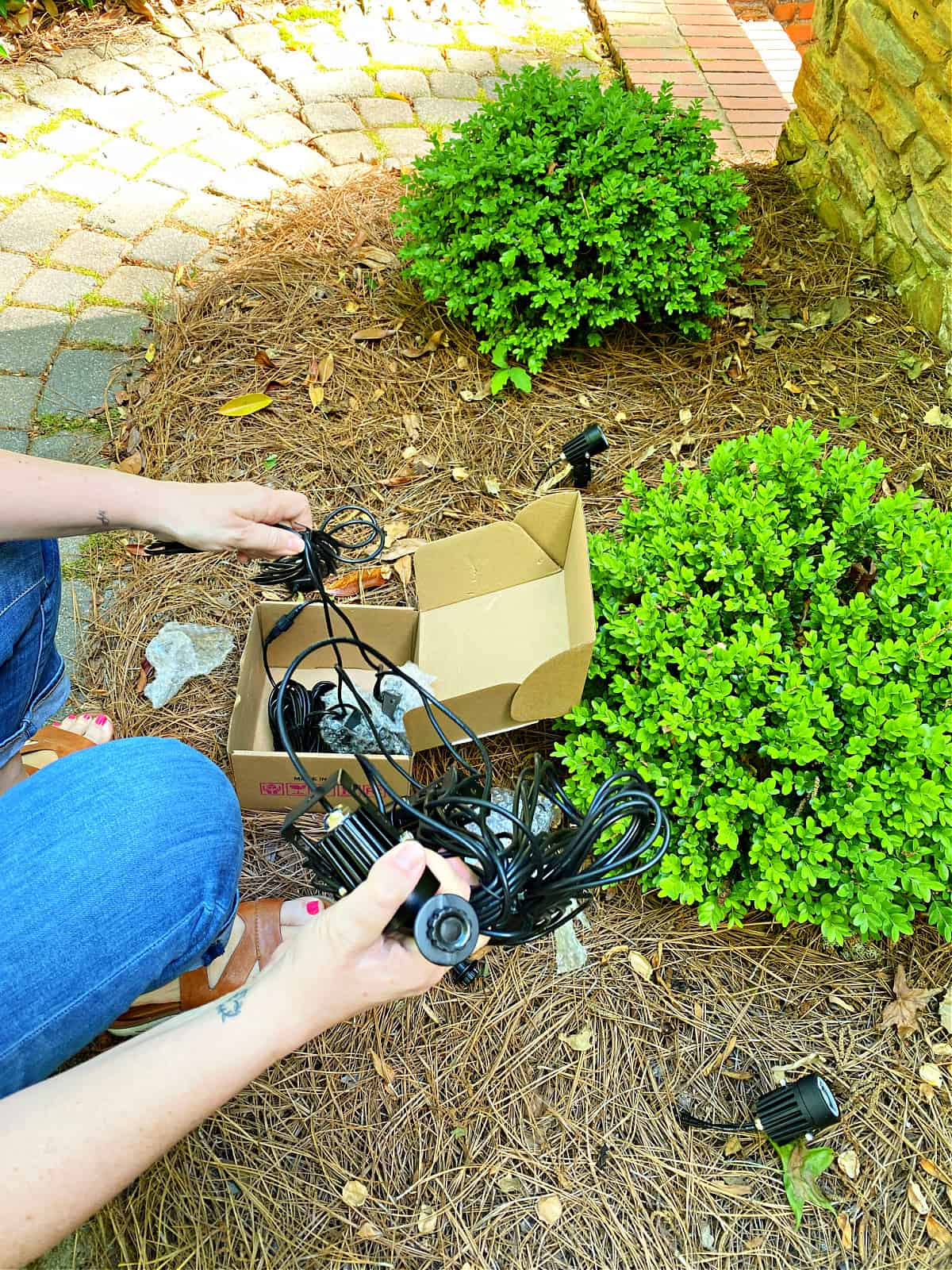 removing outdoor landscape light kit from box