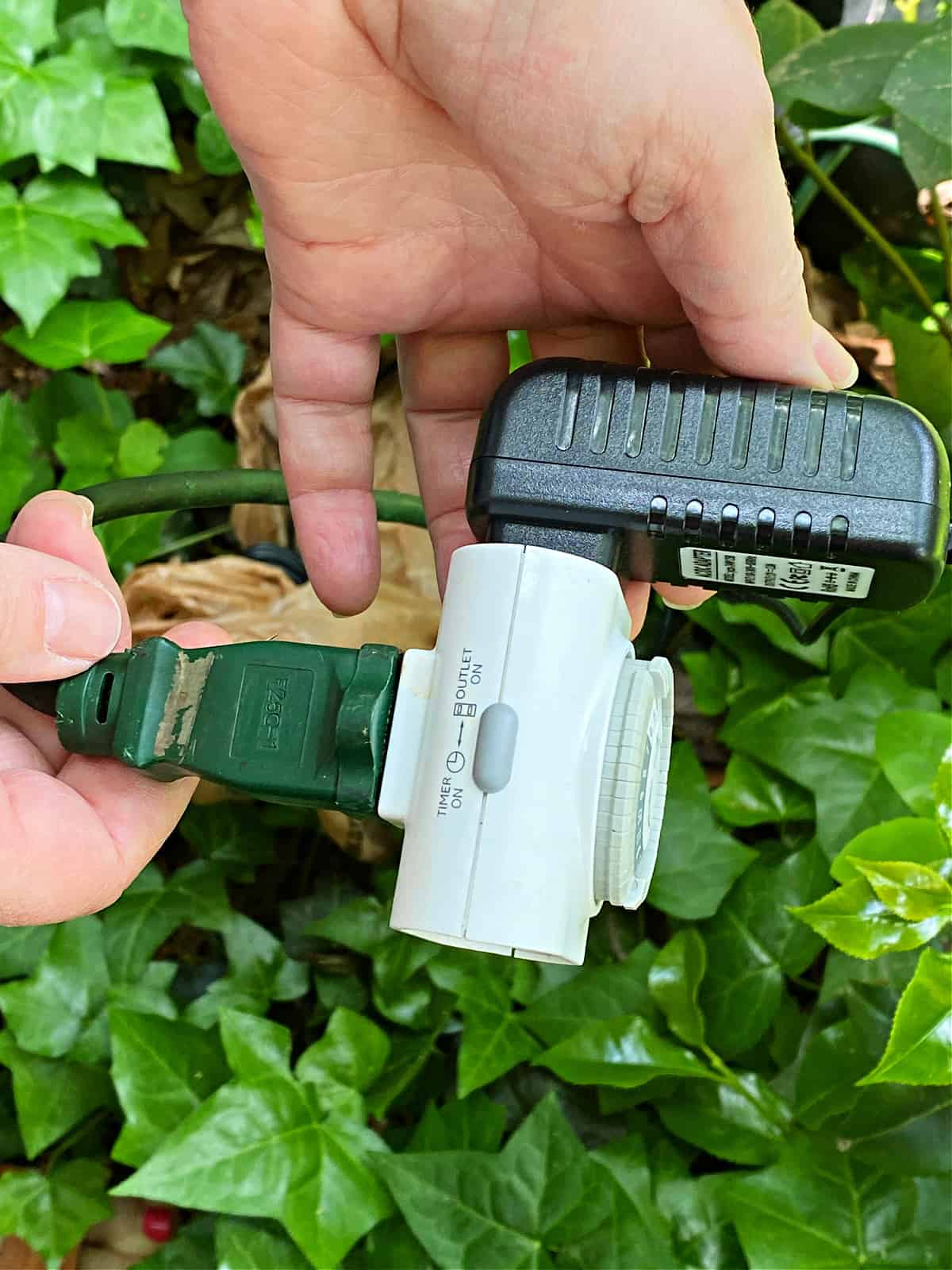 plugging landscape lights into timer and outdoor extension cord