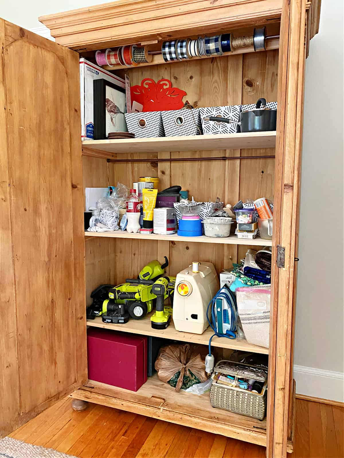 bins and supplies in craft cabinet