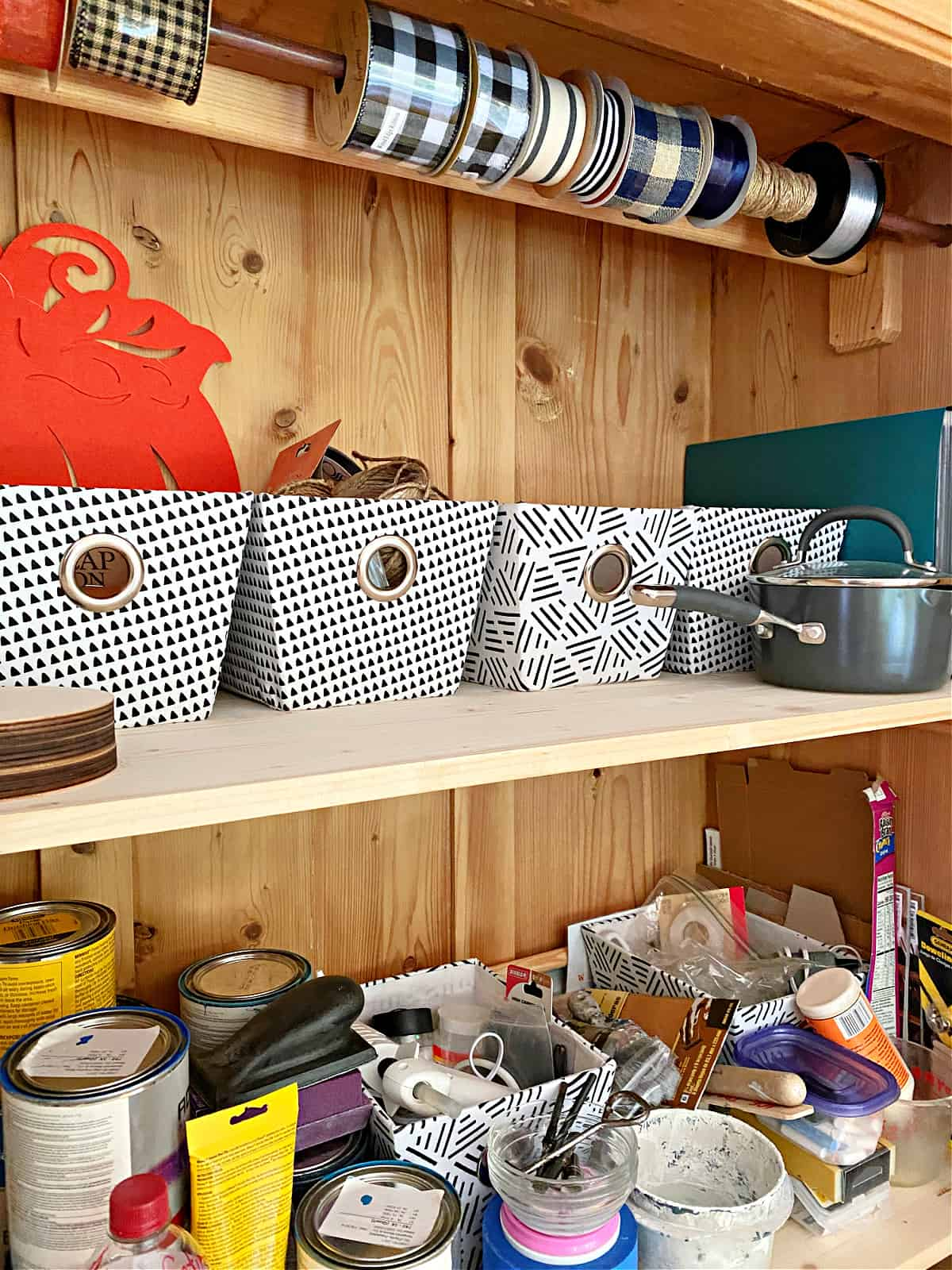 fabric storage bins and supplies in craft cabinet