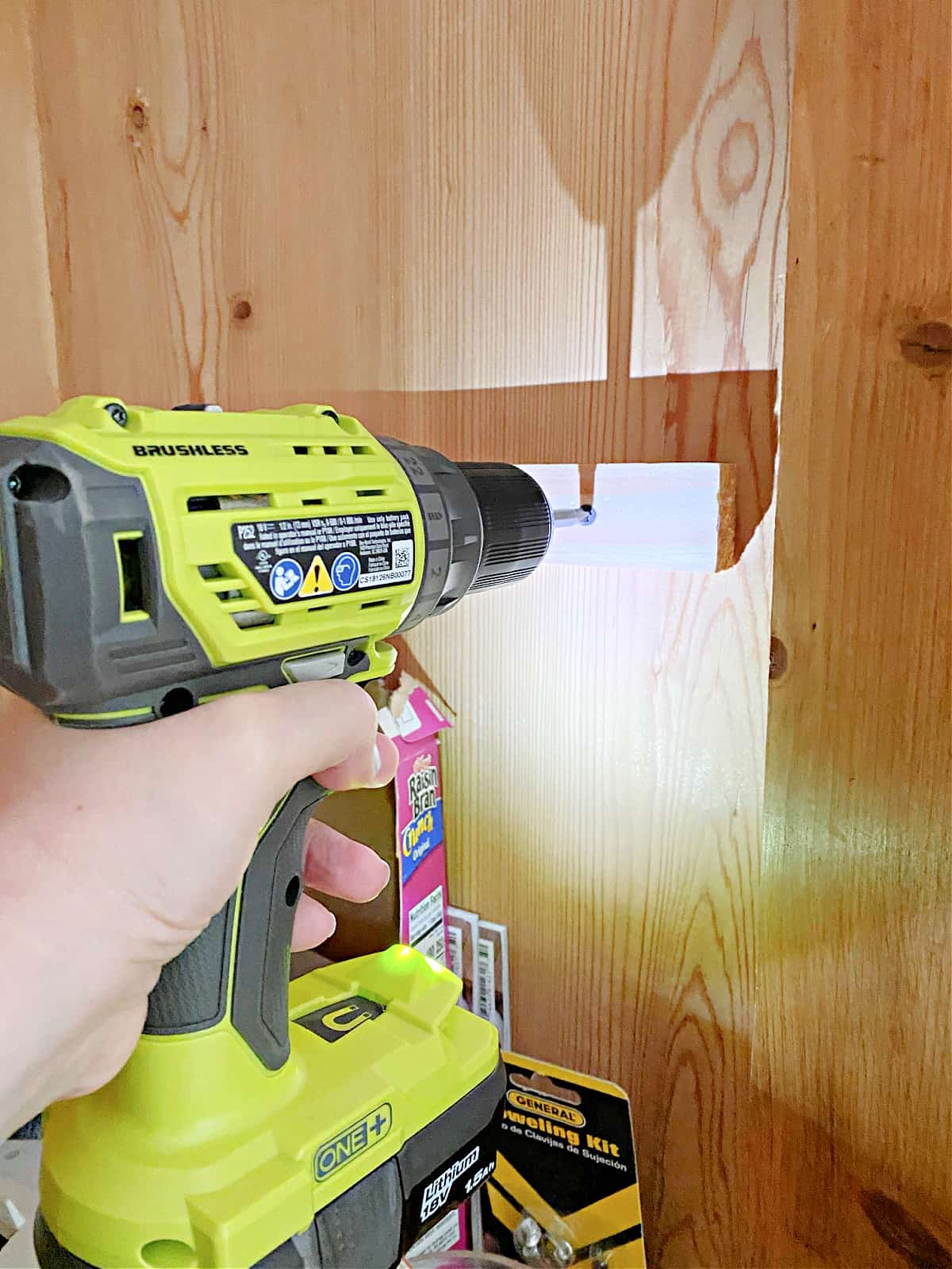 using drill to attach shelf support