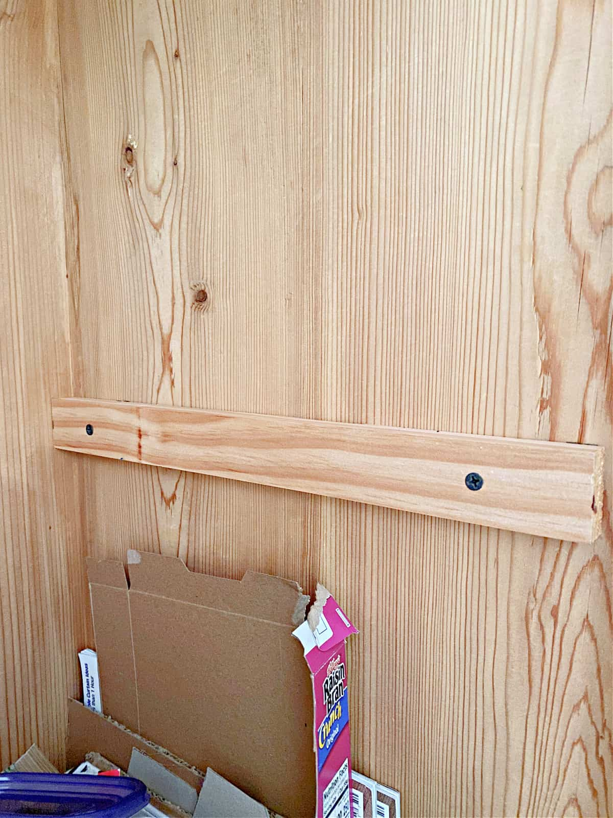 wood supports in craft cabinet