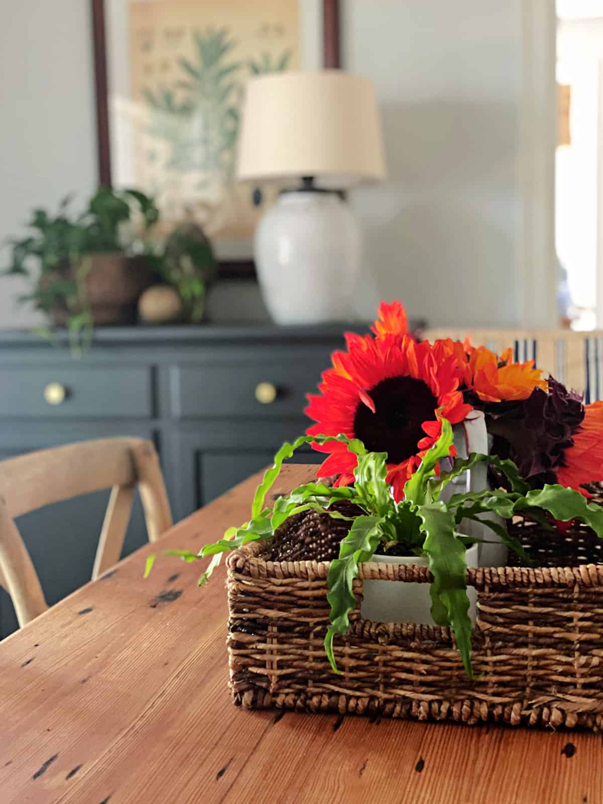 vase of sunflowers on dining room table