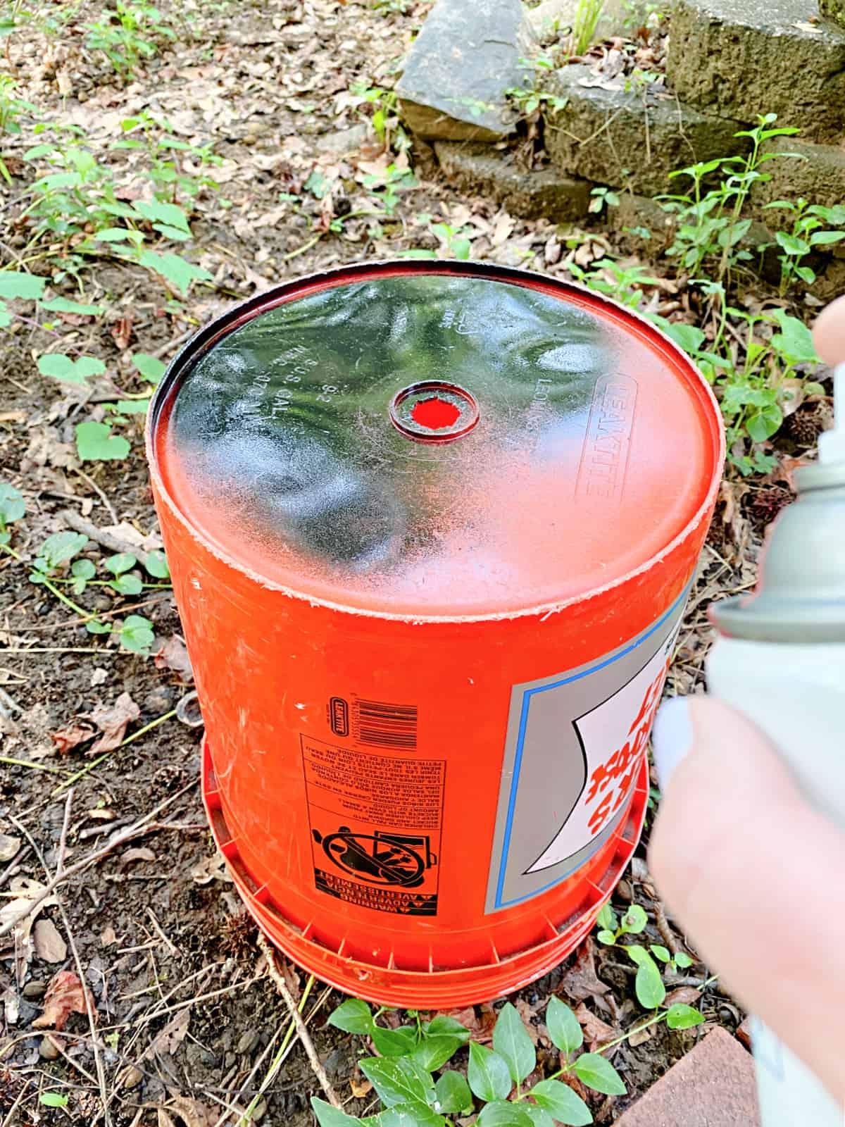 orange bucket with black paint