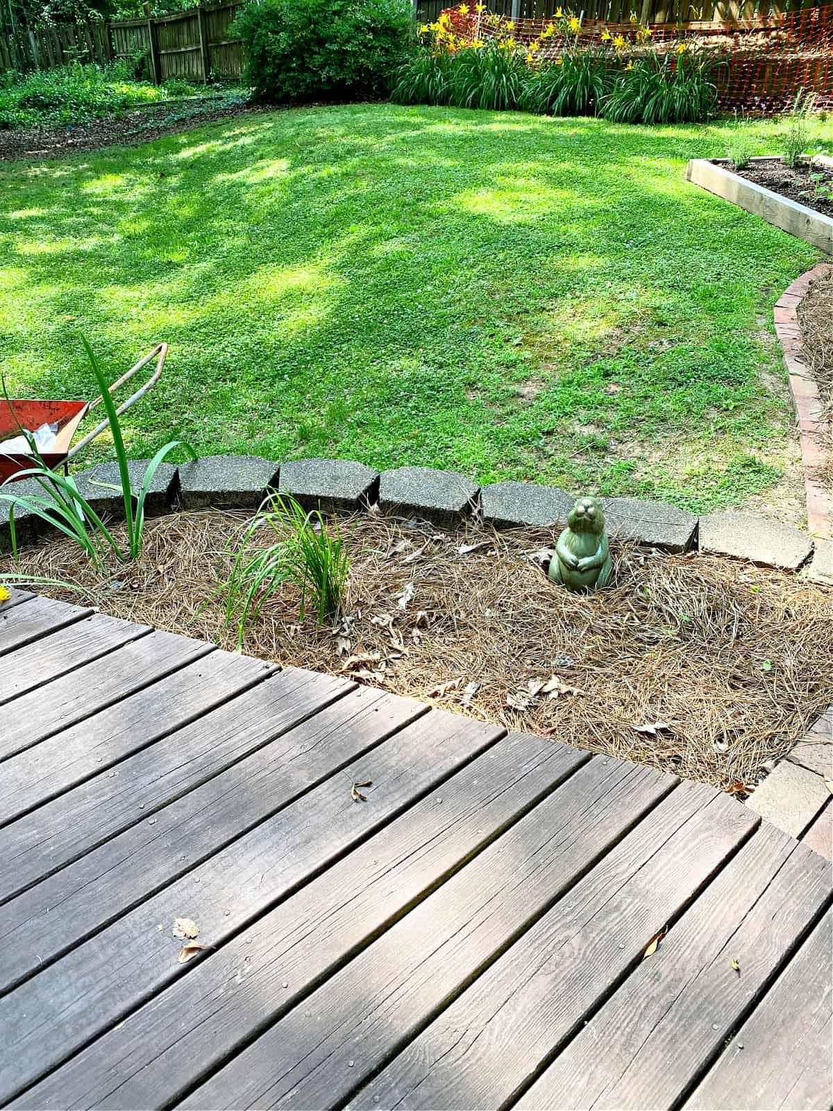 flowerbed next to deck