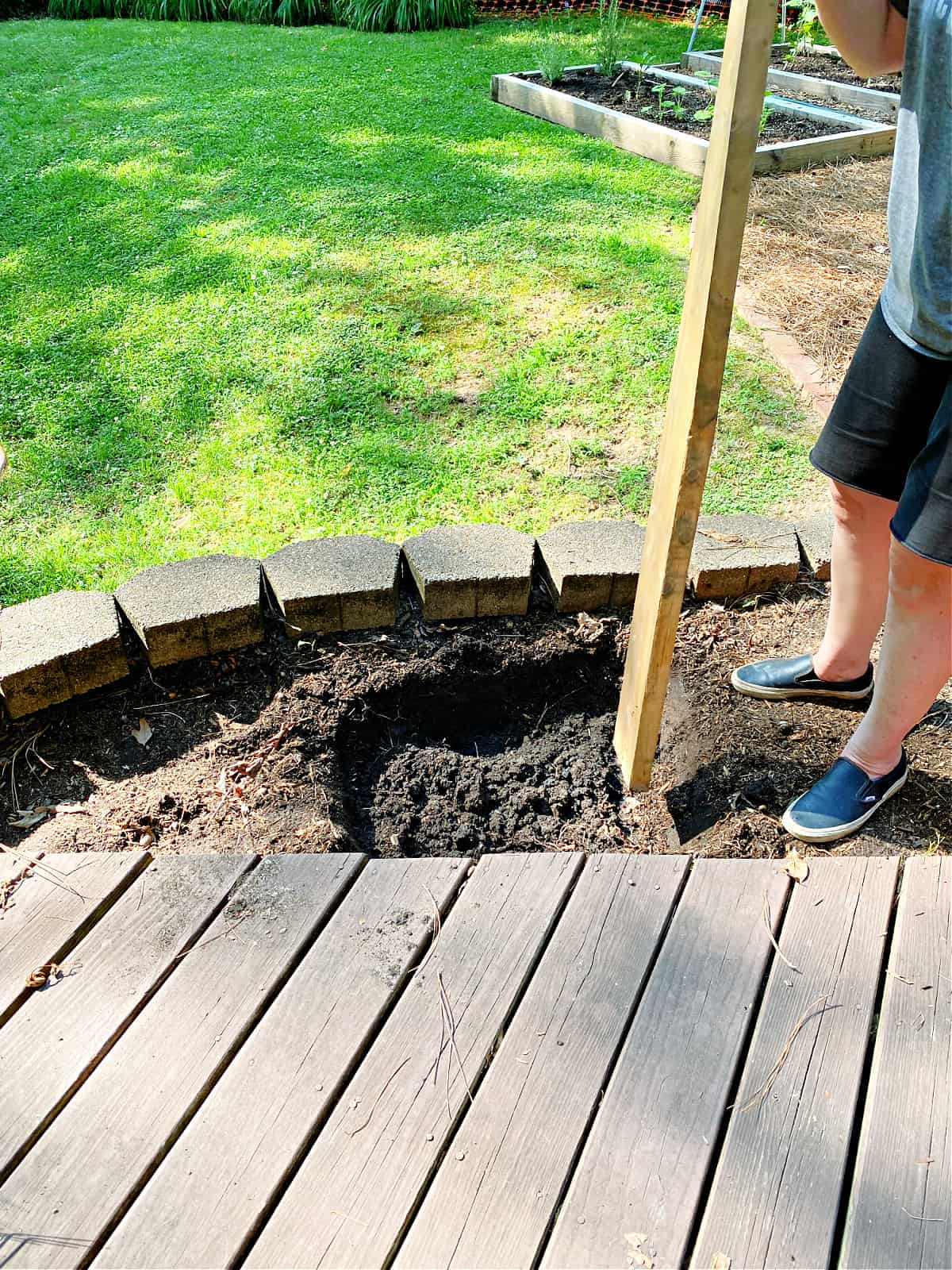 tamping dirt with board
