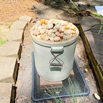 DIY fountain in flowerbed