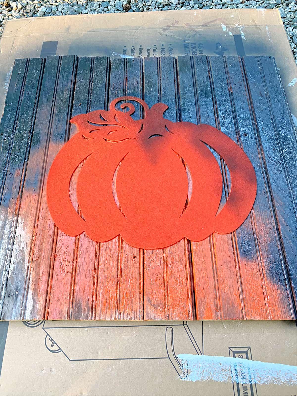 painting pumpkin sign black
