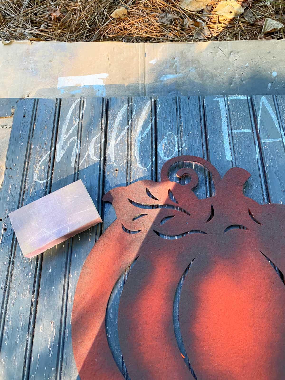 sanding block on fall wood sign