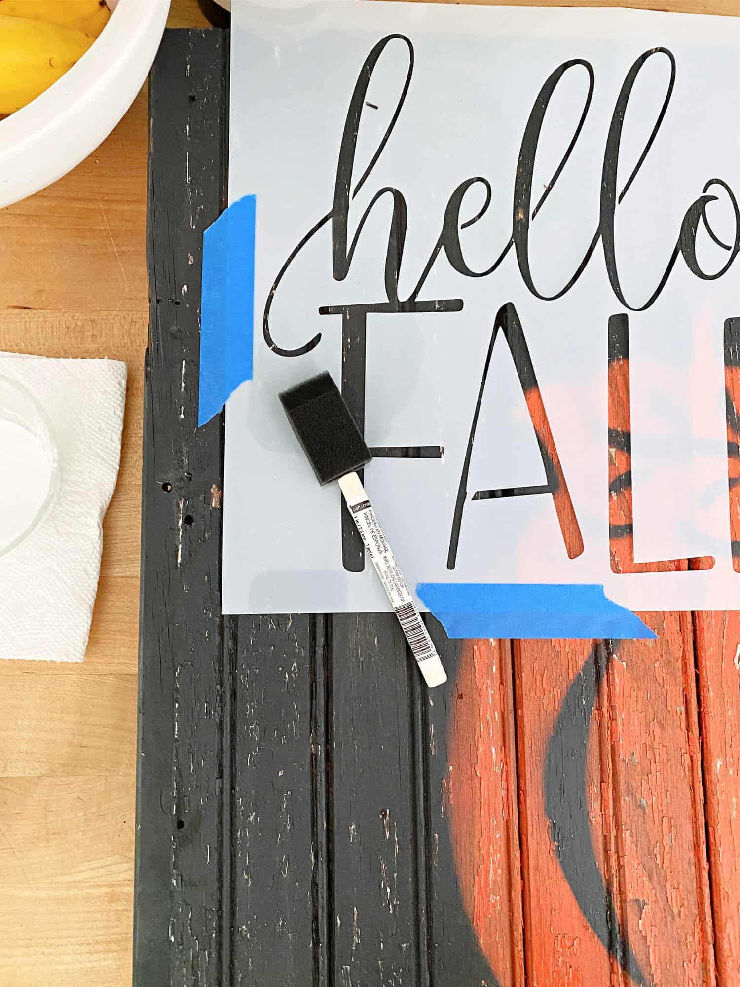 stencil and wood pumpkin sign