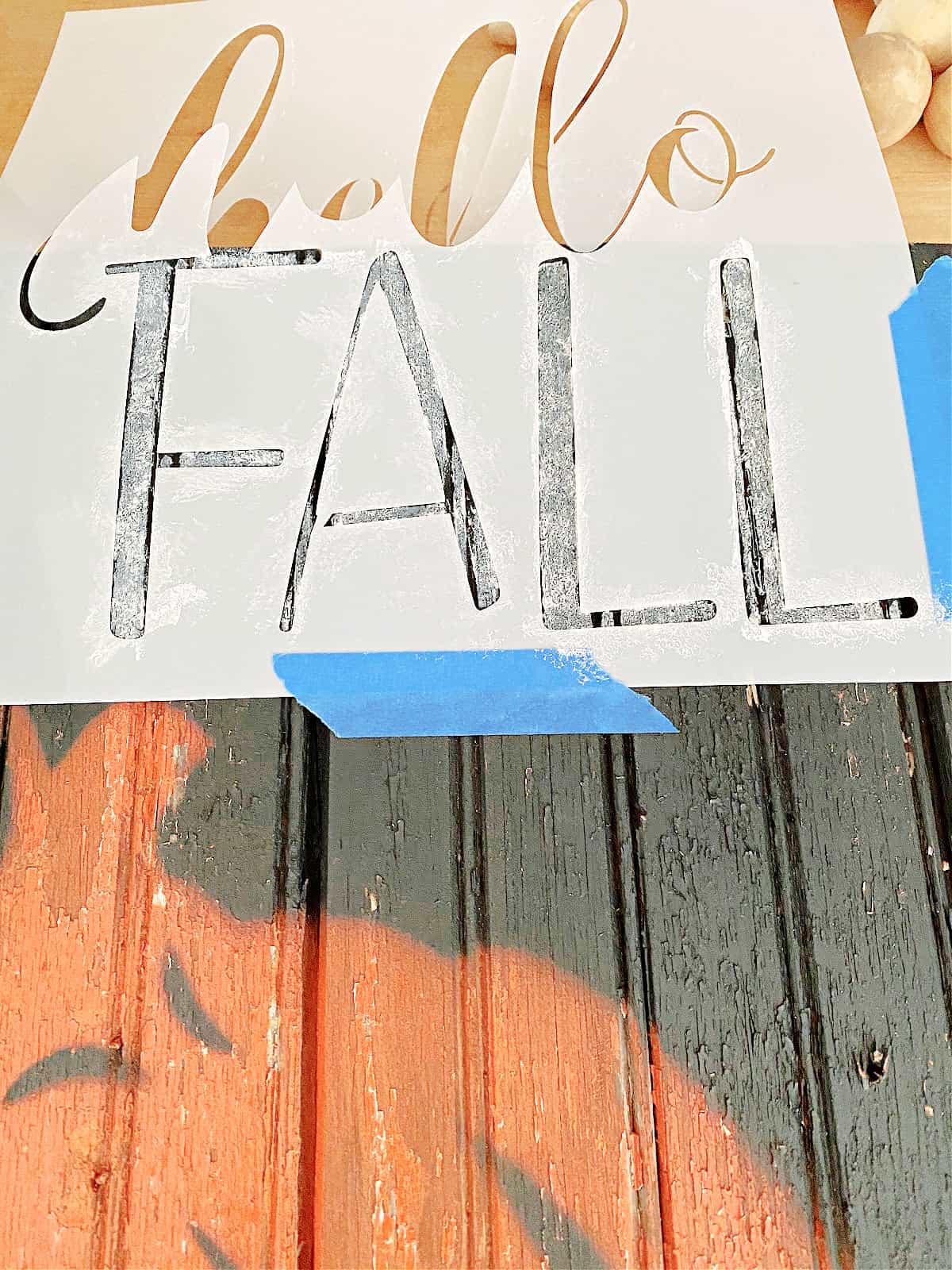 stencil on wood pumpkin sign