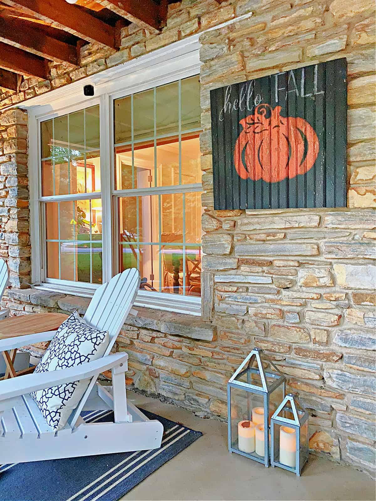 wood pumpkin sign hanging on wall